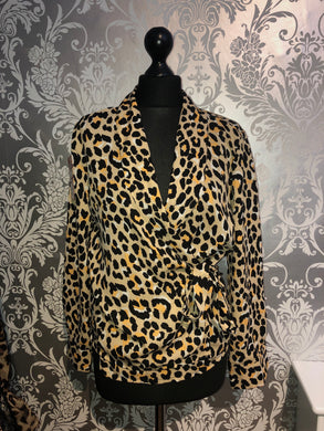 Beige and black wrap over animal blouse