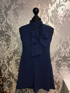 Navy sleeveless bow blouse