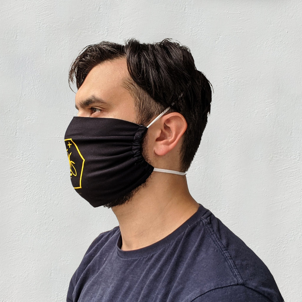 Bee positive head loop mask model side