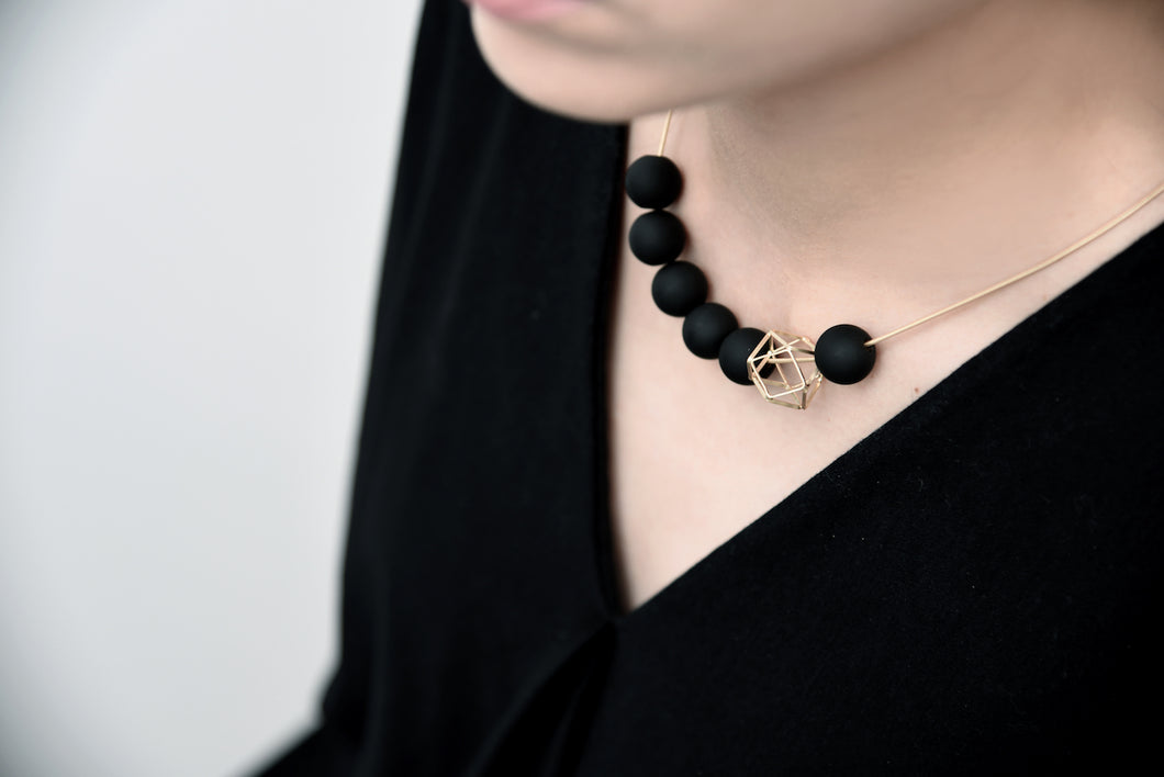 Gold Hexagon Amid Black Balls Necklace