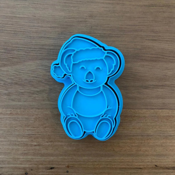 Christmas Koala wearing Singlet Cookie Cutter with optional Stamp measures approx. 80mm tall by 55mm wide.  This Koala design comes with the option of choosing the outline cutter only, or adding the optional stamp which you can use on fondant or straight on to cookies.