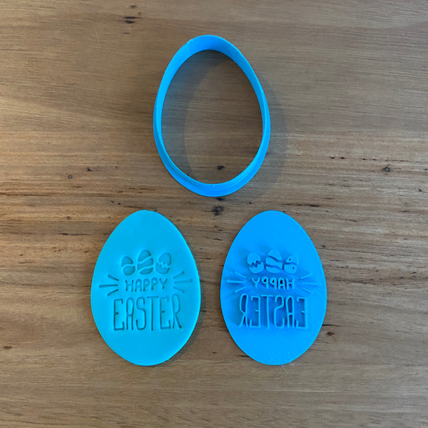 "Happy Easter Style #3 Egg Cutter and Emboss Stamp. The Egg cutter measures 80mm tall by 55mm wide.   See our complete range by searching ""Easter"" in store  The stamp is also designed to be used within a circle measuring 70mm if you prefer a round cookie"