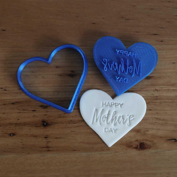 """Happy Mother's Day"" style #2 heart shaped stamp emboss and matching cutter   This design measures approx 75mm wide x 65mm tall and is a 2 piece set; the heart shaped cutter for your cookie / fondant and the matching stamp."