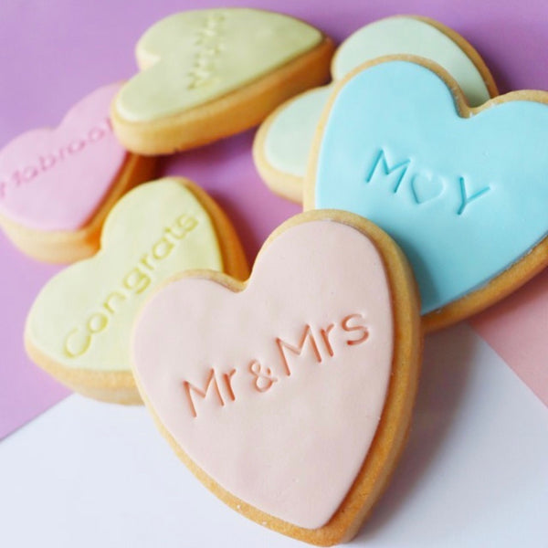"Our mini & sign cookie stamp measures 7mm, 1/4"" tall and is perfect to customise all of your special occasion cookies without needing to buy a custom stamp."