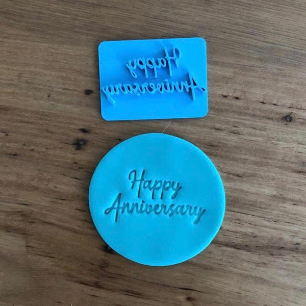 Happy Anniversary Style #1 Emboss Stamp. The words measure 45mm wide and 25mm tall and this stamp is perfect for customising your own cookies by placing the text anywhere your design requires, allowing you to place names, numbers or decorations around the text.