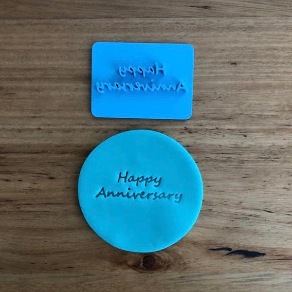 Happy Anniversary Style #2 Emboss Stamp. The words measure 45mm wide and 15mm tall and this stamp is perfect for customising your own cookies by placing the text anywhere your design requires, allowing you to place names, numbers or decorations around the text.
