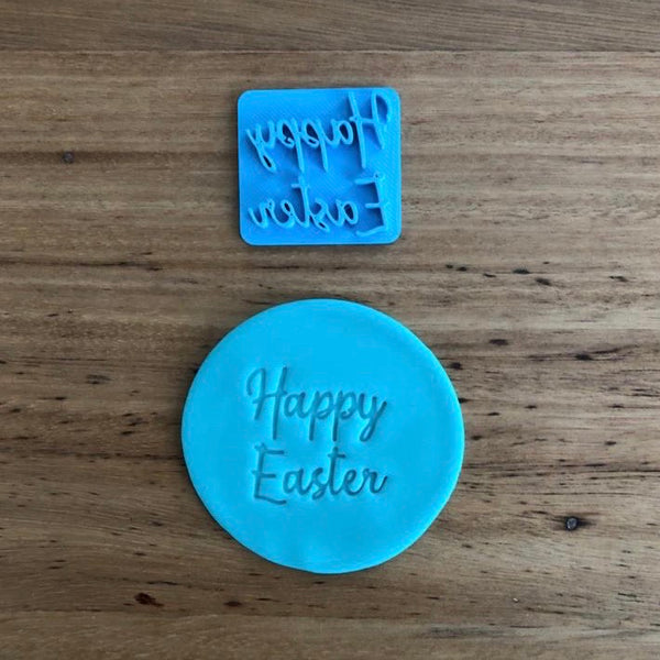 Happy Easter Style #3 Emboss Stamp. The words measure 35mm wide and 33mm tall and this stamp is perfect for customising your own cookies by placing the text anywhere your design requires, allowing you to place names or decorations around the text.