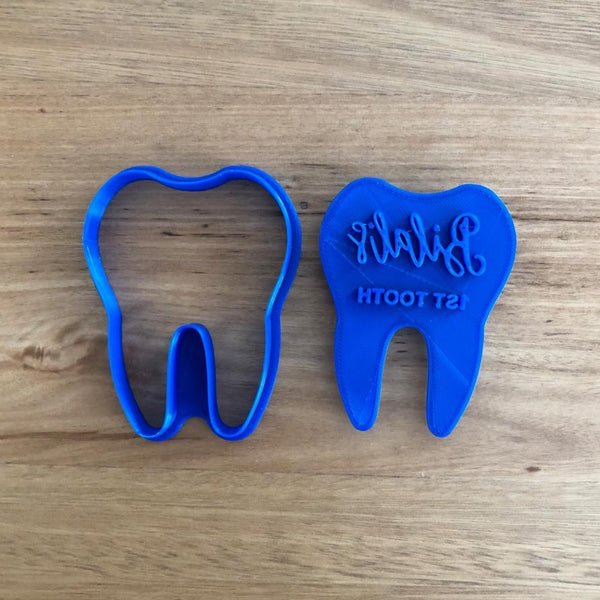 "Baby's 1st Tooth cutter and optional stamp (choose your text*) measures approx 80mm high x 60mm wide  *If you want the stamp customised, please email us at info@cookiecutterstore.com.au before hand and we will advise if the text will fit and / or if the overall size needs adjusting to suit. Customisation is included in the stamp price. You can add your Baby's name with ""1st Tooth"" below it!"
