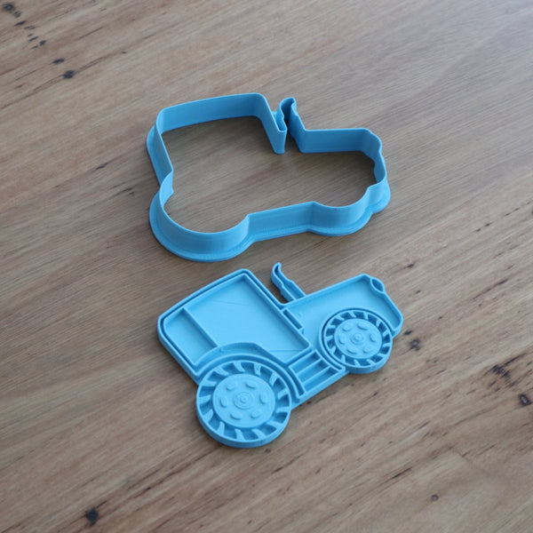 "Tractor Cookie Cutter and optional Stamp measures approx. 73mm tall by 100mm wide.  You can choose just the outline cookie cutter or add the stamp for fondant or royal icing decoration.  Also, don't miss our other vehicle themed cookie cutters, search for ""Transport"" in our search bar."
