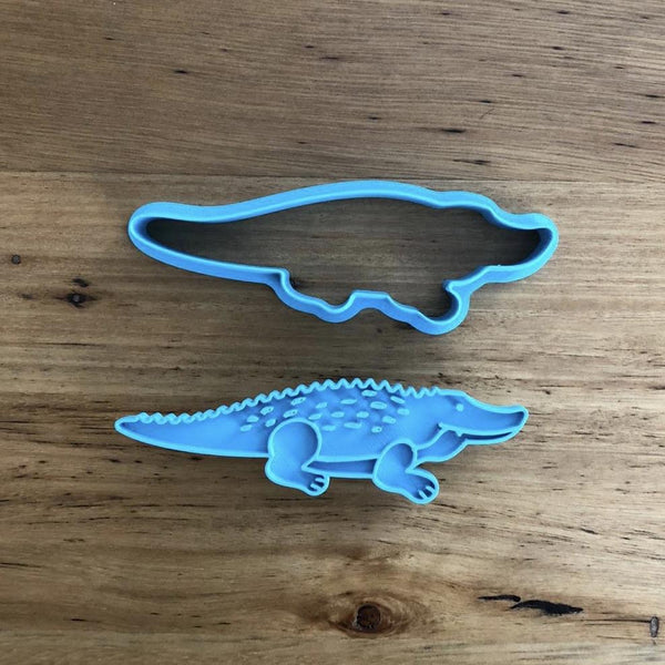 Crocodile Cookie Cutter measures approx. 30mm tall by 100mm wide.  This Crocodile design comes with the option of choosing the outline cutter only, or with the optional stamp which you can use to help with decorating, or to stamp into a plain cookie. Please note that although the crocodile is long, it is only 30mm tall. There is an alternative Crocodile option if this isn't suitable for you.