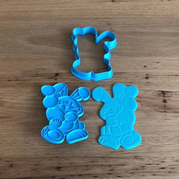 Easter Bunny holding Easter Eggs Cutter with optional Stamp. Cookie Cutter measures approx. 105mm tall by 73mm wide.  Also, don't miss our other Easter themed cookie cutters, search for