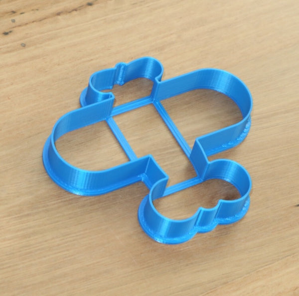 Airplane Cookie Cutter measures approx. 100mm tall by 85mm wide.