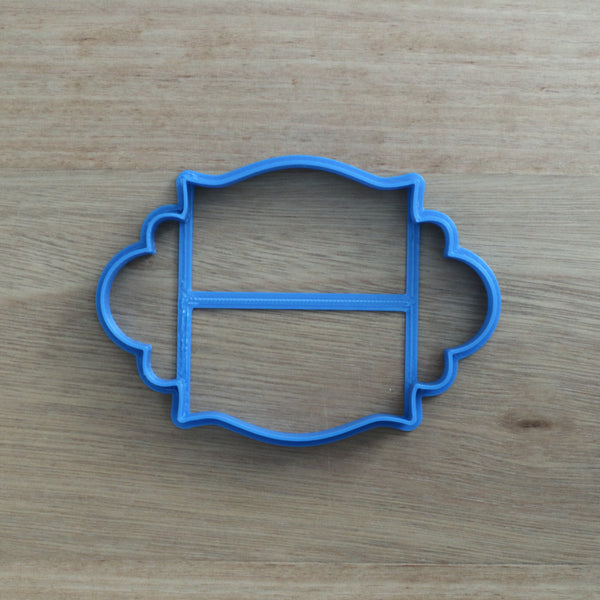 Plaque frame style (Oval) #4 cookie cutter measures approx. 70mm tall by 100mm wide.   Don't miss our other plaques, frames and shape cookie cutters  - just type in Frames or Shapes into our search bar.