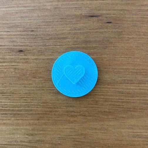 "Our mini heart cookie stamp measures 7mm, 1/4"" tall and is perfect to customise all of your special occasion cookies without needing to buy a custom stamp.  There are 2 styles to choose, the outline or the solid design."