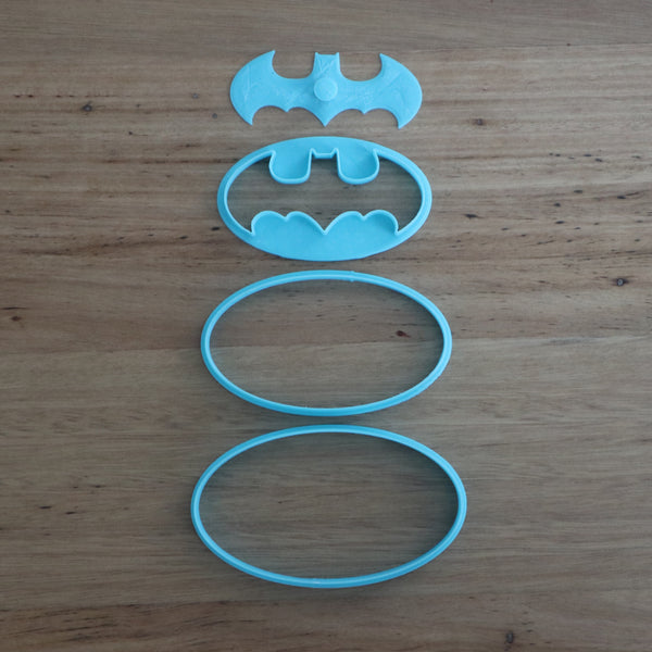 Batman Cookie Cutter and Stamp set measures approx. 60mm tall by 105mm wide.  This set comprises of 4 pieces to help you make awesome Batman cookies with fondant decoration:  1) Oval for Cookie Cutter and black fondant base,  2) Oval (smaller) for yellow fondant,  3) Bat shape for black fondant,  4) Bat shaped plunger to help extract the delicate bat shape fondant from cutter 3,