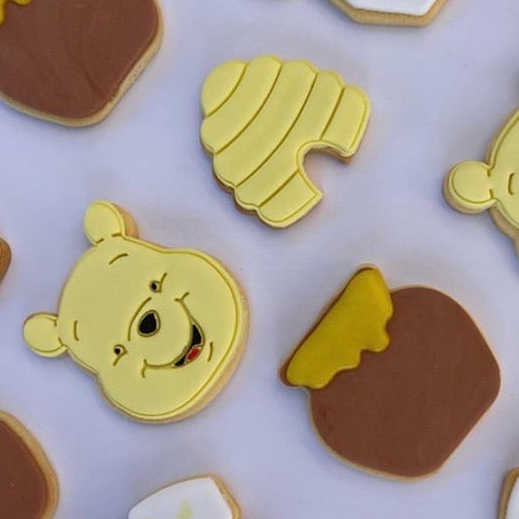 winnie the pooh, honey pot and bee hive cookies decorated by @_cookiesbycourtney