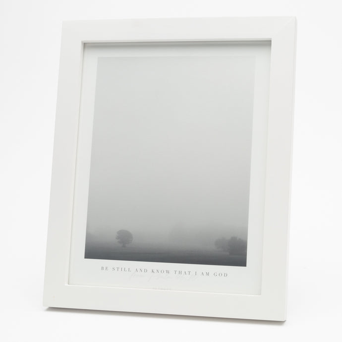 Black and white print of tree in fog with Psalm 46:10 at the bottom in a white frame