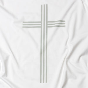 Close up of simple, elegant and linear Christian cross in gray on white t shirt