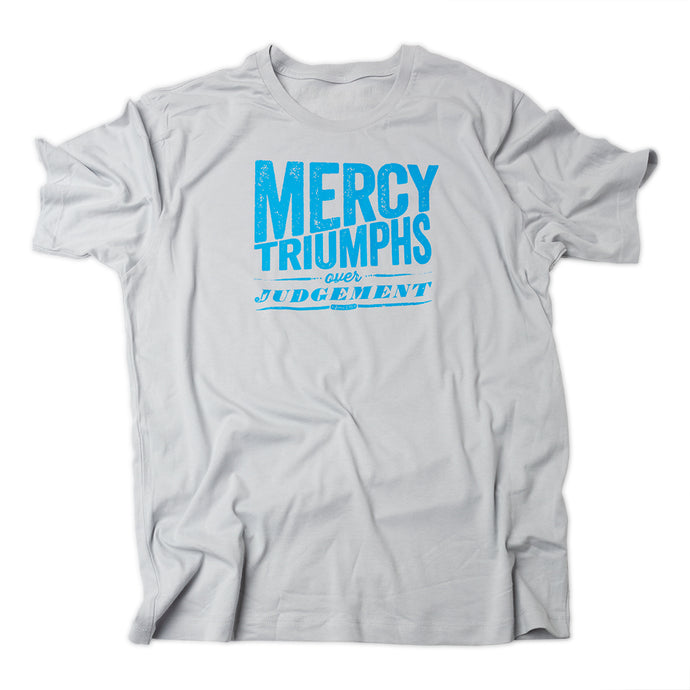 James 2:13, Mercy triumphs over judgement, printed in blue on back of gray t shirt.