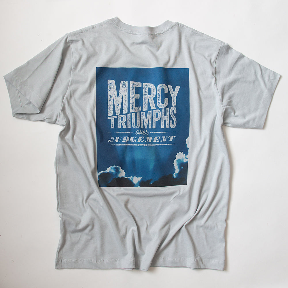 James 2:13, Mercy triumphs over judgement, on blue sky photo on light grey t shirt