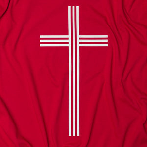 Close up of White Christian Cross with 3 vertical and 3 horizontal lines on red t shirt
