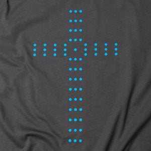 Close up of Charcoal t shirt with light blue cross made of circles