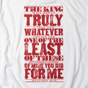 Close up of Matthew 25:40 in bold, textured design printed in red on white t shirt