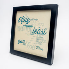 Load image into Gallery viewer, Matthew 25:40 printed in modern, textured design in blue on pale yellow paper in black frame.