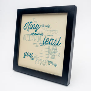 Matthew 25:40 printed in modern, textured design in blue on pale yellow paper in black frame.