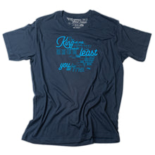 Load image into Gallery viewer, Matthew 25:40 printed in light blue on navy t shirt and as the tag
