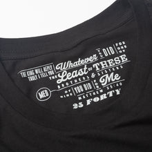 Load image into Gallery viewer, Bible verse Matthew 25:40 printed in light gray as the tag for a black t shirt