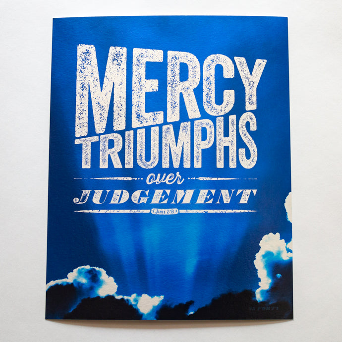 Mercy triumphs over judgement, James 2:13, with dramatic blue sky on metallic fine art paper