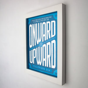 Framed (white) Print with Onward and Upward graphic and Philippians 3:14 printed with shades of blue, and white type