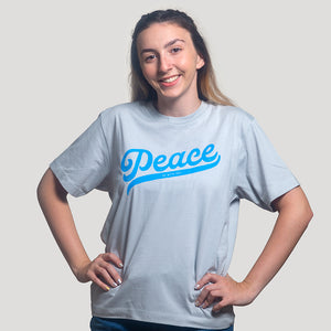 "Brunette model wearing light blue Christian t-shirt with ""Peace be with you""  in bright blue on the front"