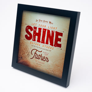 Metallic photo print with Matthew 5:16 in textured type with wooden background in black frame