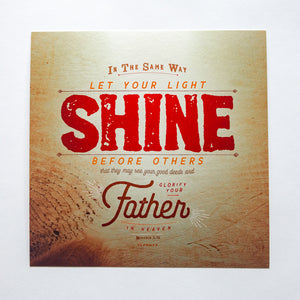 Metallic photo print with Matthew 5:16 in textured type with wooden background