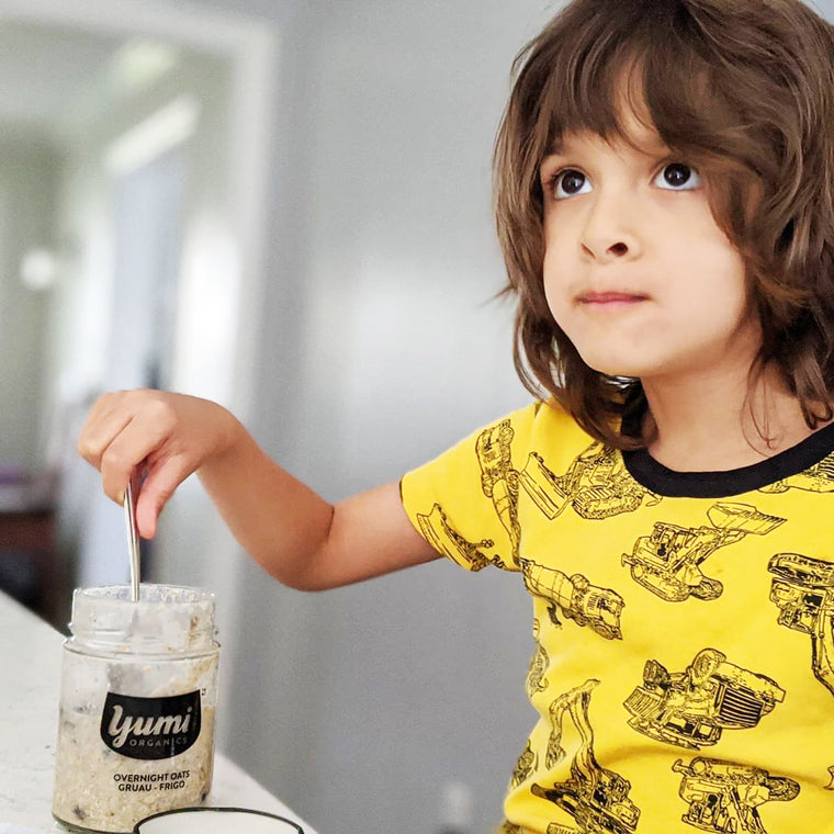 child with yumi overnight oats in kitchen