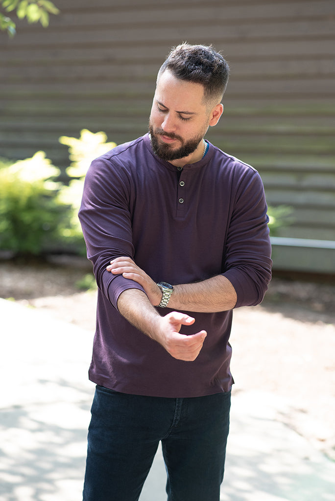 man wearing a purple henley