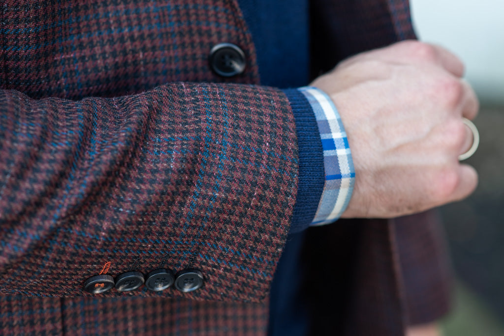 layered fall outfit with sport coat and hooded sweater