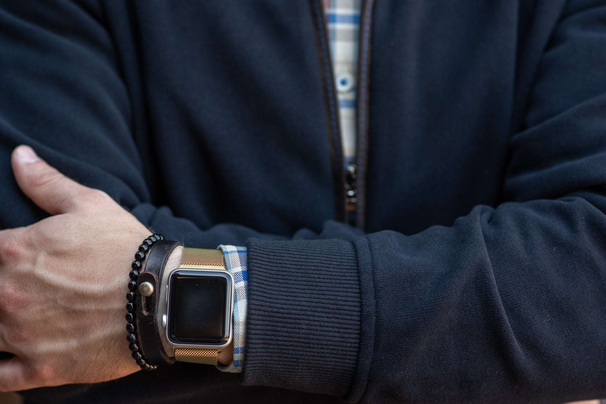 apple watch with bracelets and sweater