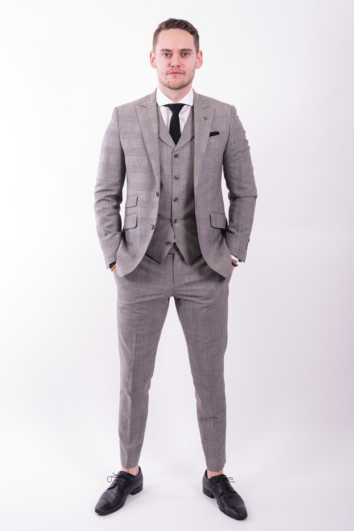 custom three piece grey flannel suit from Ticknors