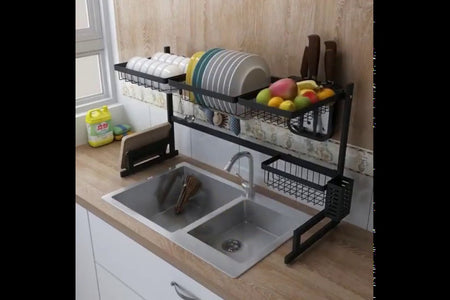 SPACE SAVER - This dish drying rack expands for use on the counter, in the sink or over the sink