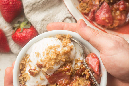This vegan strawberry crisp is bursting with juicy strawberries, sweetened with maple syrup, and topped with a decadent oat-crumble topping