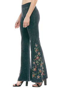 Black mineral wash yoga pants with floarl embroidery. Wide bell bottom flare. Made in USA