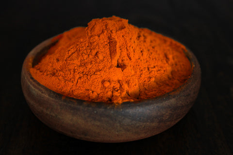 Strong potent curcumin extract shown in wooden bowl