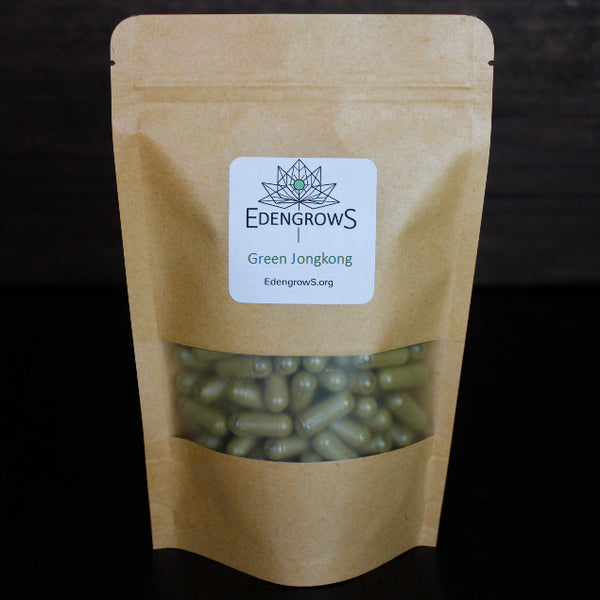 Green Jongkong leaf powder in capsules put in a fresh keeping sealed bag for shipping