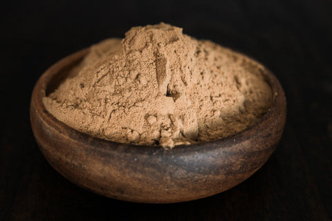 Excellent fresh kava powder presented in a wooden bowl