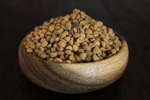 Hawaiian baby woodrose seeds in a wooden bowl