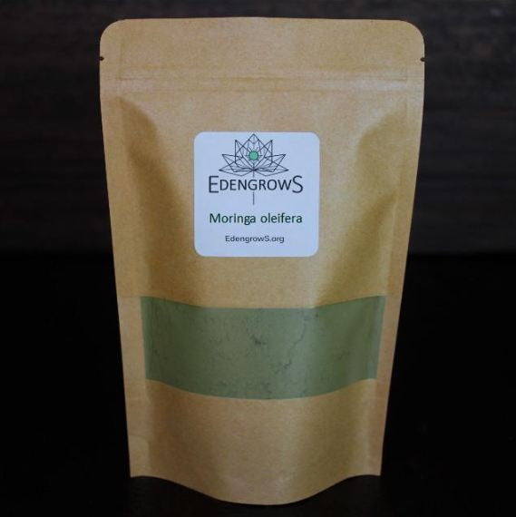 Finely grounded moringa powder in a sealed bag for shipping