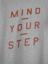 "Load image into Gallery viewer, THE ORIGINAL COLLECTION.  ""Mind Your Step"". Unisex T-Shirt, V-Neck, Heather Grey"